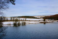Wintry View over Resevoir. A view over Tunstal Resevoir and snow covered hills looking the north Stock Photos