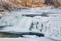 Wintry Waterfall. Indiana's Mill Creek flows through a wintry frozen landscape and over Lower Cataract Falls Royalty Free Stock Photos