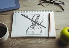Wiolonczelowy doodle na notepad z kawą i zieleni jabłkiem Obrazy Stock