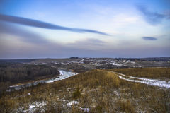 Wioska i rzeka przy zmierzchem Obrazy Stock