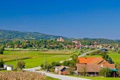Wioska Komin zieleni krajobraz Fotografia Stock