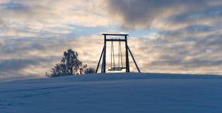 Wioski huśtawka w zimie Fotografia Royalty Free