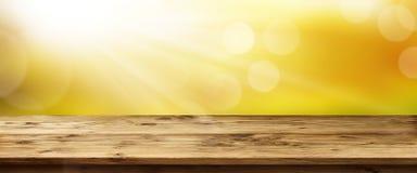 Wiosny tło z wschodem słońca i stołem Obrazy Royalty Free