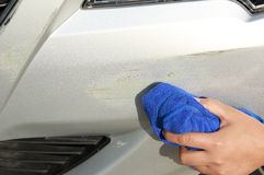 Wipe off the scratches on car Royalty Free Stock Image