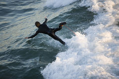 Wipe Out. A surfer wipes out on a gnarly wave royalty free stock images