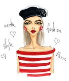 Wipe stylish girl in beret and striped blouse. Royalty Free Stock Image