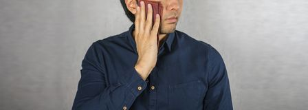 Wipe the sweat, handkerchief placed on man face.  Stock Photo
