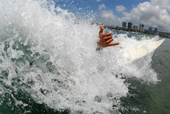 Wipeout Hawaii style. A shortboard surfer wipingout while giving a shaka Royalty Free Stock Photography