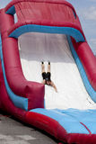 Wipeout 5K Run obstacles course - the drop. Woman and man at the drop slide obstacle at the Wipeout 5K Run obstacles course in Wilmington, DelawarennThe Wipeout royalty free stock images