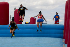 Wipeout 5K Run obstacles course - Sky's the Limit. Runners at the Sky's the Limit obstacle at the Wipeout 5K Run obstacles course in Wilmington, DelawarennThe royalty free stock images