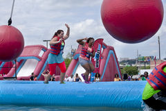 Wipeout 5K Run obstacles course - wrecking balls Stock Photo