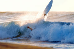 Wipe Out. A surfer wipes out on a big wave on coastal beach break in Many, Sydney, Australia Royalty Free Stock Photos