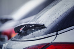 Wiper blade on the car glass. Wiper blade and water droplets on the car glass with shallow depth of field Royalty Free Stock Photos