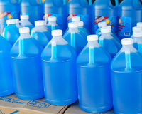 Wiper fluid. This is a shot of blue windshield wiper fluid bottles Stock Photography