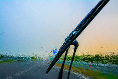 Wiper on a wet windshield Stock Photos