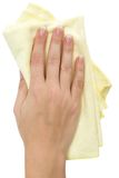 Wiping. Female hand wiping with a yellow rag. Isolated on a white background Stock Photo