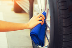Wiping alloy wheels Stock Photography