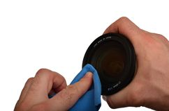 Wiping camera lens Royalty Free Stock Image
