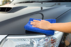Wiping on car Royalty Free Stock Image