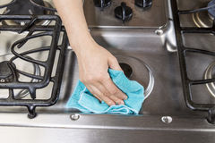 Wiping down Stove top Range Royalty Free Stock Photography