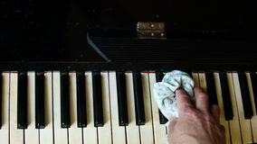 Wiping dust from piano stock video footage