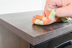 Wiping a dusty cabinet Stock Photos