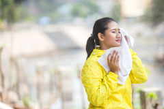Wiping her sweat with a towel Stock Photography