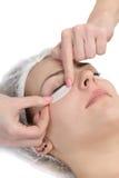 Wiping mascara from eyelashes Stock Photography