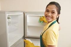 Wiping new freezer Stock Photo