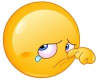 Wiping tear emoticon. Sad emoticon wiping a tear Royalty Free Stock Photos