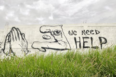 Wir benötigen Hilfe. Stockfotos
