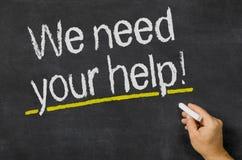 Wir benötigen Ihre Hilfe Stockbild