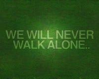 Wir gehen nie alleine auf Gras Stockbild