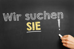 Wir suchen SIE! (We are looking for YOU!). Hand writes in German Wir suchen SIE! (We ware looking your YOU!) on blackboard Stock Photos