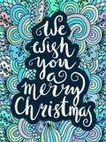 Wir wünschen Ihnen frohen Weihnachten - zitieren Sie auf kopiertem Hintergrund Stockfotos