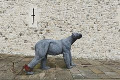 Wire animal sculptures of the white bear by Kendra Haste installed at the Tower of London, England. London, UK - April 2018: Wire animal sculptures of the white royalty free stock photography