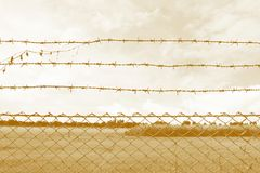 Barbed wire imprison, detention center, incarcerate, Barbed wire detention center at countryside and background sepia color style. Wire Barbed imprison stock photos
