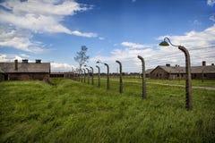 Wire. Barbed wired fence and barracks, Auschwitz II-Birkenau, Poland Stock Image