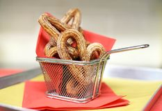 Wire basket of crunchy churros pastries Royalty Free Stock Image