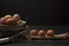 Wire basket with fresh eggs and fabric and whisk Royalty Free Stock Photo