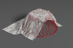 Wire basket with lace cloth Royalty Free Stock Photo