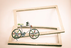 Wire bicycle model,paper frame Stock Images