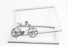 Wire bicycle model,paper frame on white background Stock Photos