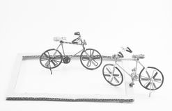Wire bicycle model,paper frame on white background Royalty Free Stock Photography