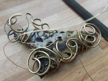Wire brass and jasper stone Royalty Free Stock Photos