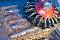 Wire brush for mechanical cleaning of metal.  Royalty Free Stock Image