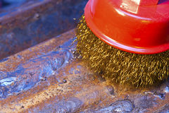Wire brush for mechanical cleaning of metal Royalty Free Stock Photo