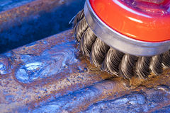 Wire brush for mechanical cleaning of metal Stock Photo