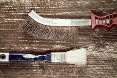 Wire brush and paintbrush Stock Image