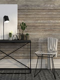 Wire Chair And Metal Table Against A Wall Of Brown Boards Stock Photography